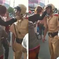 Video: Cô gái tát cảnh sát giữa phố