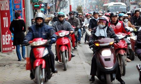 Đề xuất cấm xe máy trong giờ cao điểm - 1