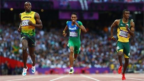 Bolt dễ dàng vào chung kết chạy 200m - 1