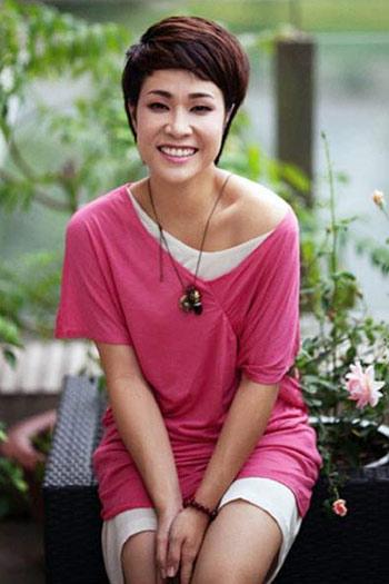 Mỹ nhân Việt khoe cá tính cùng tóc ngắn - 14