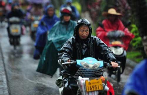 Chùm ảnh siêu bão Utor tàn phá Trung Quốc - 11