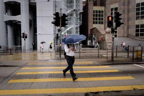 Chùm ảnh siêu bão Utor tàn phá Trung Quốc - 14