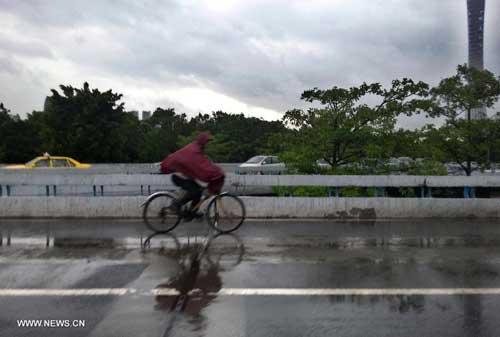 Chùm ảnh siêu bão Utor tàn phá Trung Quốc - 6