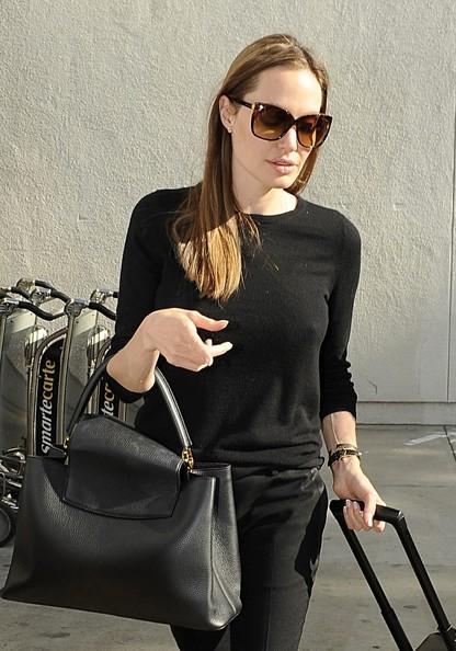 """Angelina Jolie tự tin dù lộ """"bí mật"""" - 3"""