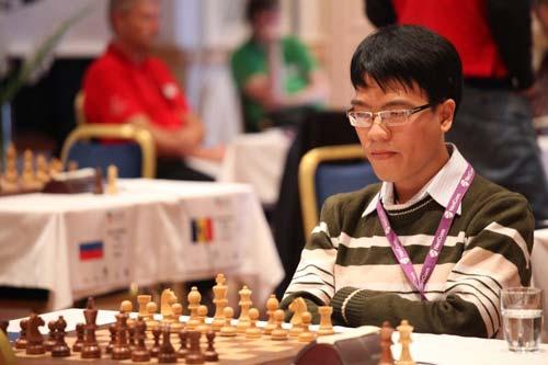 Quang Liêm chia điểm với nhà vô địch thế giới - 1