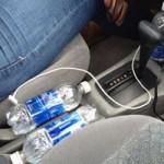 Sức khỏe đời sống - Uống nước đóng chai để trong xe hơi bị ung thư?