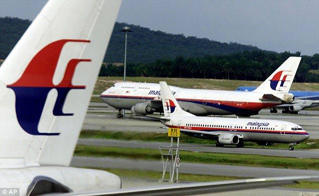 Malaysia Airlines cân nhắc đổi tên sau thảm họa MH17 - 1
