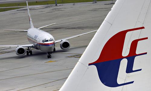 Máy bay Malaysia Airlines lại suýt gặp thảm họa - 1