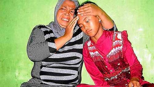 Cô bé đoàn tụ với gia đình sau 10 năm mất tích - 1