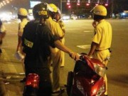 An ninh Xã hội - Cô gái vi phạm giao thông còn đấm vào mặt cảnh sát