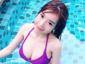 Elly Trần khoe đường cong đẹp khó tin bên bể bơi