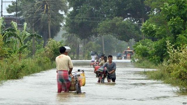 Ảnh: Người dân châu Á oằn mình trong mưa lớn, lũ quét - 1