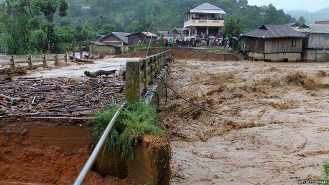 Ảnh: Người dân châu Á oằn mình trong mưa lớn, lũ quét - 3