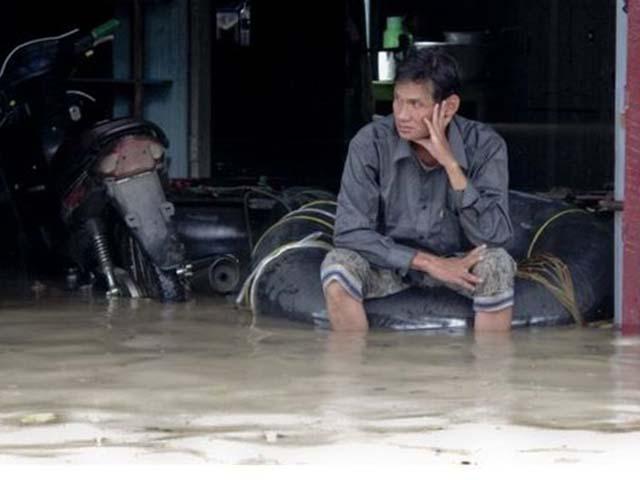 Ảnh: Người dân châu Á oằn mình trong mưa lớn, lũ quét - 6