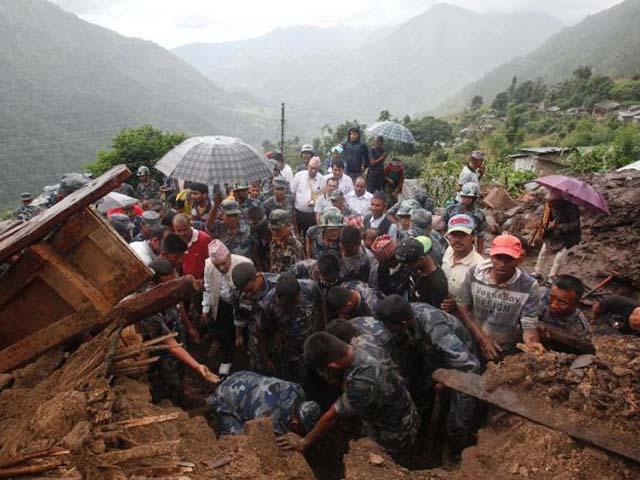 Ảnh: Người dân châu Á oằn mình trong mưa lớn, lũ quét - 7