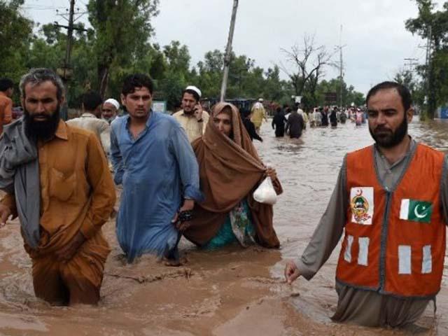 Ảnh: Người dân châu Á oằn mình trong mưa lớn, lũ quét - 9