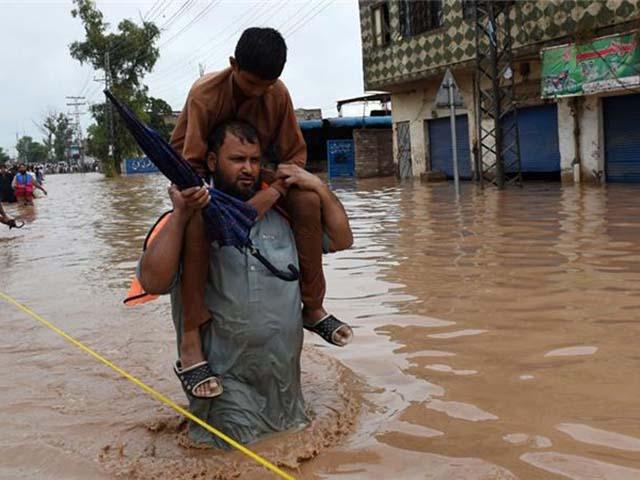 Ảnh: Người dân châu Á oằn mình trong mưa lớn, lũ quét - 10