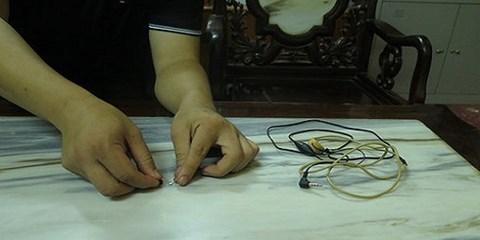 Phát hiện thí sinh cài thiết bị công nghệ cao quanh người - 1