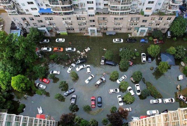 Ảnh: Siêu bão tấn công TQ, gần nửa triệu người sơ tán - 7