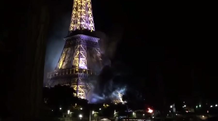 Tháp Eiffel bốc khói dữ dội sau vụ khủng bố ở Pháp - 2