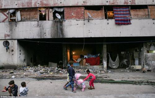 Cuộc sống tại khu ổ chuột sát SVĐ Olympic ở Brazil - 9
