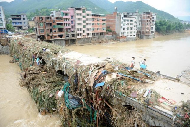 Siêu bão khiến 83 người chết, TQ sa thải 3 quan chức - 1