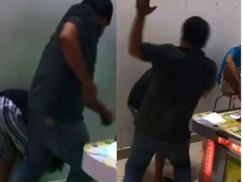 Bé trai bị 2 người đàn ông đánh, chích điện ở Sài Gòn - 1