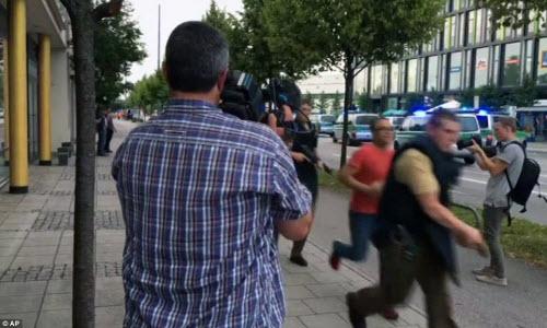 Ảnh hiện trường xả súng khiến 10 người chết ở Đức - 8