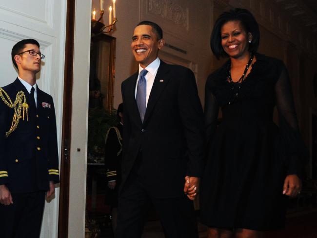 Ảnh: 7 năm làm tổng thống, Obama già đi thế nào? - 3