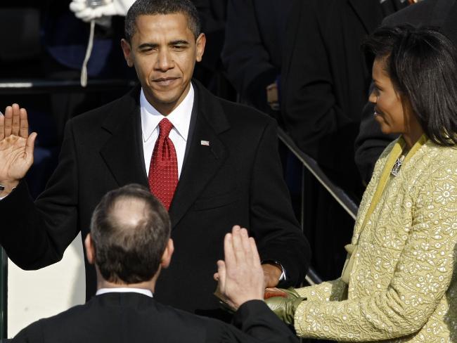Ảnh: 7 năm làm tổng thống, Obama già đi thế nào? - 2