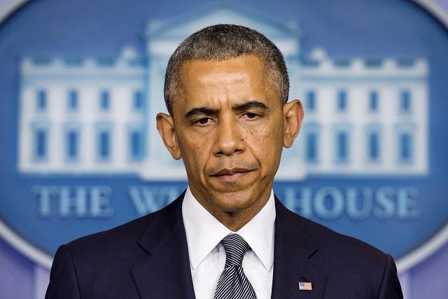 Ảnh: 7 năm làm tổng thống, Obama già đi thế nào? - 1