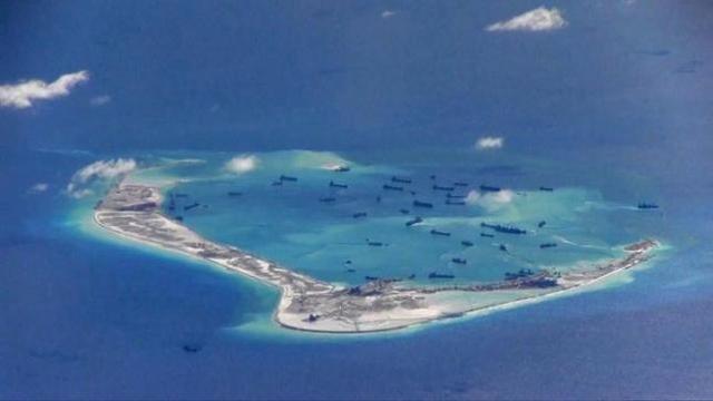 Báo Mỹ: TQ gia cố kho chứa máy bay ở Trường Sa - 1