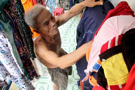 """Cuộc sống của """"đại gia đình"""" 37 người bán vé số ở Sài Gòn - 11"""