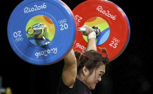 """Kỷ lục """"khủng"""" ở Olympic 2016: Từ Hoàng Xuân Vinh tới Michael Phelps - 8"""