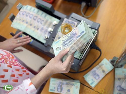 Thêm 60.000 tỉ đồng nợ xấu đã được xử lý - 1