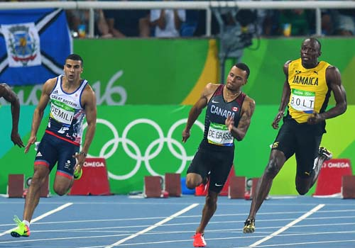 """Bái phục Usain Bolt: Chạy như đùa vẫn """"vô đối"""" - 7"""
