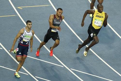 """Bái phục Usain Bolt: Chạy như đùa vẫn """"vô đối"""" - 6"""
