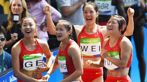 Bị loại 4x100m, đội điền kinh Trung Quốc kêu oan - 1