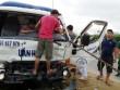 Huy động xe container cứu tài xế kẹt trong cabin bẹp dúm