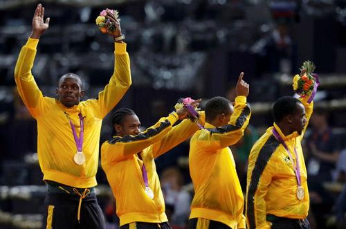 """Usain Bolt thần tốc giành """"hat-trick"""" HCV - 4"""