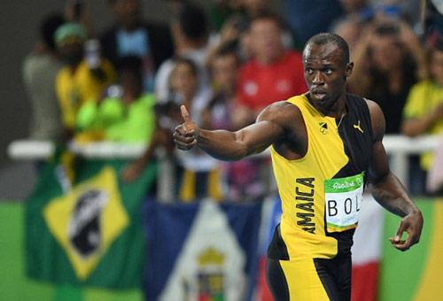 """Usain Bolt thần tốc giành """"hat-trick"""" HCV - 1"""
