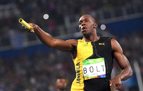 Giải nghệ với cú ăn ba HCV, Bolt được mời làm Bộ trưởng - 1