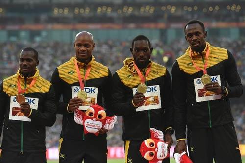 Sắp bị tước 1 HCV Olympic, Bolt chẳng hề lo lắng - 1