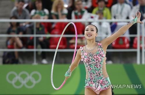 Thẫn thờ xem VĐV xinh như Hoa hậu tranh tài Olympic - 9