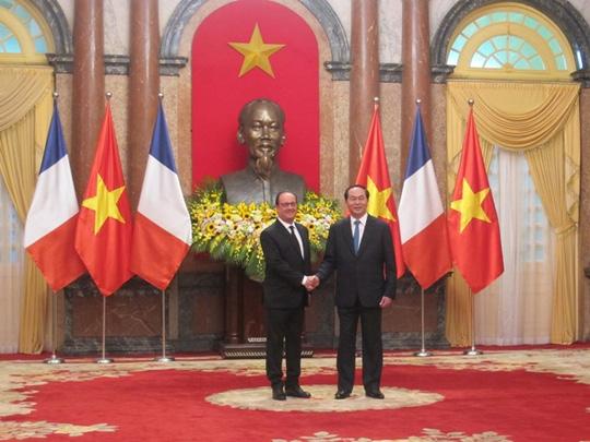 Chủ tịch nước Trần Đại Quang đón Tổng thống Pháp - 7