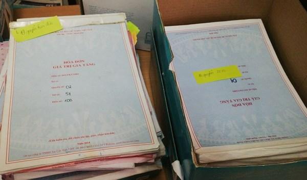 Đánh sập ổ nhóm mua bán hóa đơn giả tiền tỷ ở Hà Nội - 1