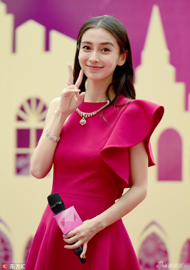Sốc vì nhan sắc không photoshop của vợ Huỳnh Hiểu Minh - 1