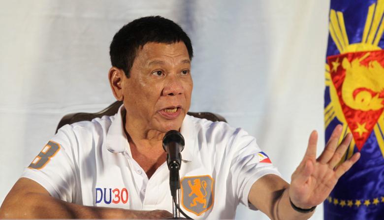 Hình xăm tiết lộ quá khứ của Tổng thống Philippines - 4