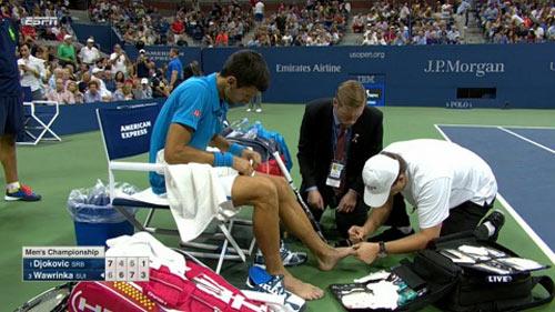 US Open: Nghi án Nole giả đau, chơi chiêu với Wawrinka - 1