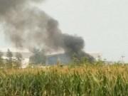 Thế giới - Biểu diễn xong, máy bay TQ lao xuống đồng, 4 người chết